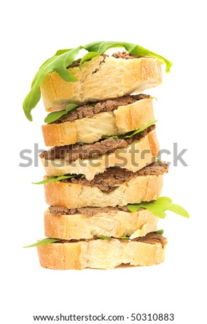 sandwiches: pate and arugula leaves on slices of baguette. Antipasto ...