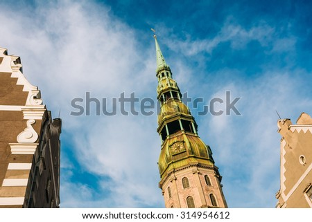 Tower of St. Peter's Church. It is a Lutheran church in Riga, the capital of Latvia, dedicated to Saint Peter. It is a parish church of the Evangelical Lutheran Church of Latvia. - stock photo