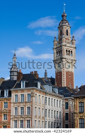 Tower of the Chambre de commerce and historic houses in Lille, France