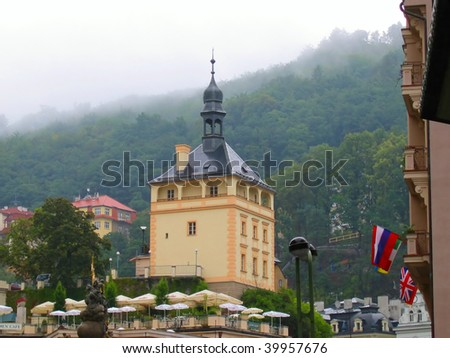 Tower on the background of the mountains in Karlovy Vary, Czech Republic - stock photo