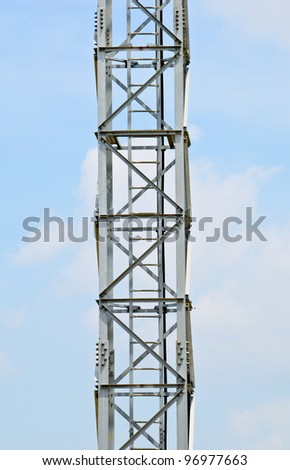 Tower part of the large antenna on a blue sky. - stock photo