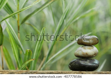 Tower stone with bamboo in the background. Concept of tranquility and relaxing. - stock photo