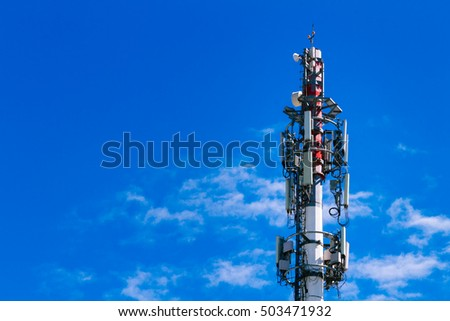 Tower with cell phone antennas blue sky background
