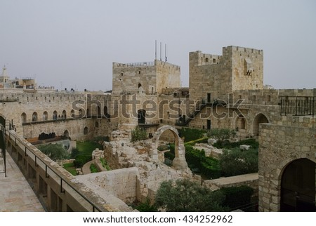 Towers and walls of Jerusalem citadel and Tower of David  in sandstorm.  Israel - stock photo