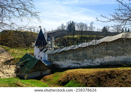 Towers and walls of the fortress of Holy Dormition Pskov-Caves Monastery in Pechory, Russia - stock photo