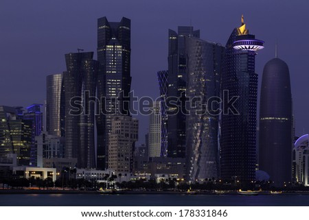 Towers in the business district of Doha, Qatar, in the blue light of dusk. - stock photo