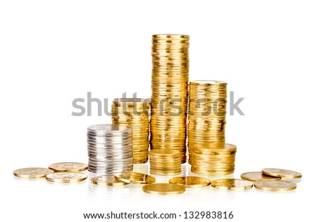 Towers made out of gold and silver coins over white background - stock photo