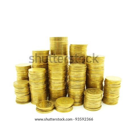 towers of coins isolated on a whiteness - stock photo