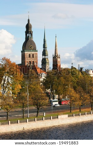 Towers of Old  Town (Riga, Latvia) in autumn. View from Daugava river - stock photo