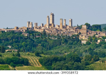 Towers of World Heritage Site Village San Gimignano on the top of a Hill during summertime, Italy - stock photo