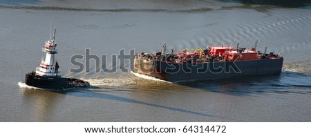 Towing a barge down the Hudson River - stock photo