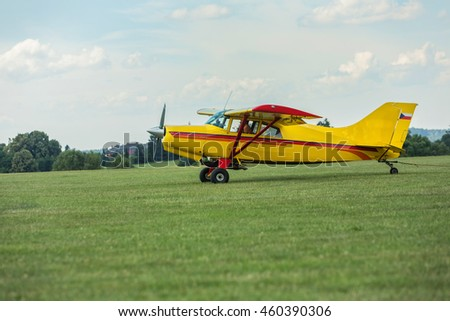 Towing aircraft on a grassy airport ready for takeoff.
