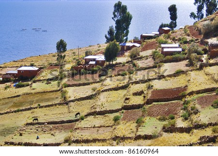 Town and field around Titicaca lake, Peru - stock photo