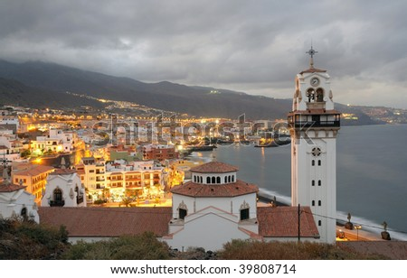 Town Candelaria at dusk. Canary Island Tenerife, Spain - stock photo