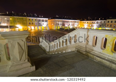 Town Hall at night, Main Square (Rynek Wielki), Zamosc, Poland - stock photo