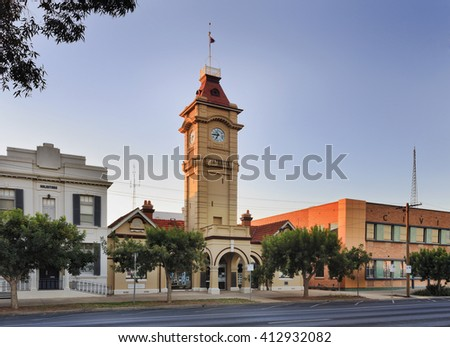 Town hall facade facing street with tall clock tower at sunrise in a small regional town Mildura, of Australia. - stock photo