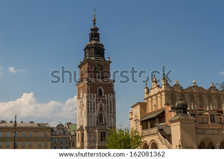 Town hall tower on main square of Krakow - stock photo