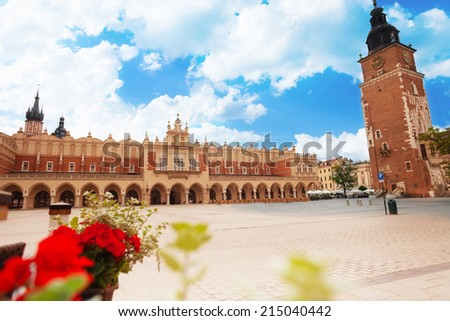 Town Hall Tower (Wieza ratuszowa w Krakowie) and Cloth Hall on Rynek Glowny (main square) in Krakow, Poland - stock photo