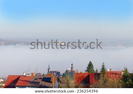 town in the fog - stock photo