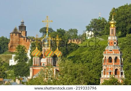 Town Nizhniy Novgorod in Russia, middle ages fortress Kremlin and Stroganovskaya church of Saint Mary. - stock photo
