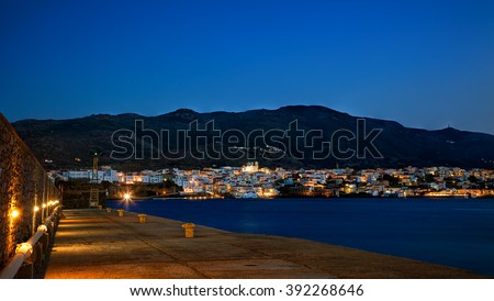 Town of Chora viewed at dusk, in Andros island, Cyclades, Greece - stock photo
