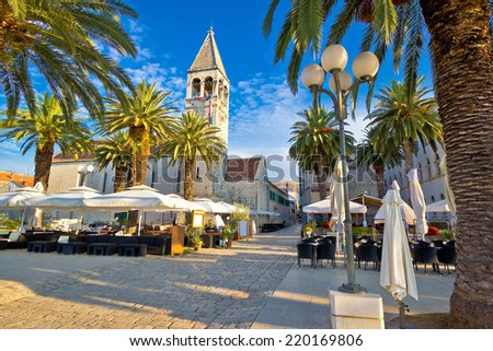 Town of Trogir palm promenade, UNESCO world heritage site in Dalmatia, Croatia - stock photo