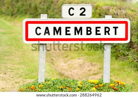 Town sign of the Camembert village, birthplace of famous cheese - stock photo