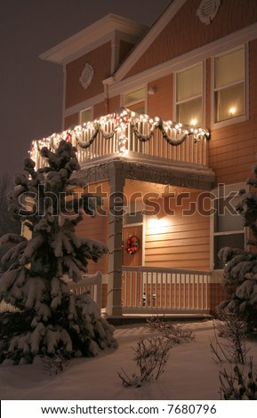 Townhouse decorated with lights and lots of snow - stock photo