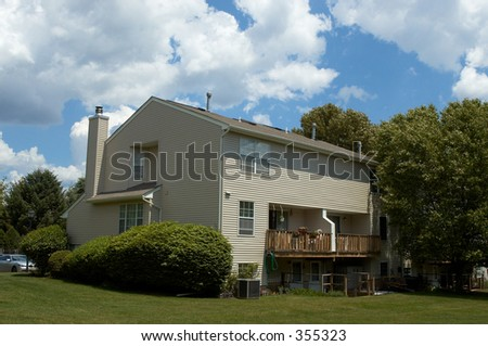 townhouse with balcony and porch - stock photo