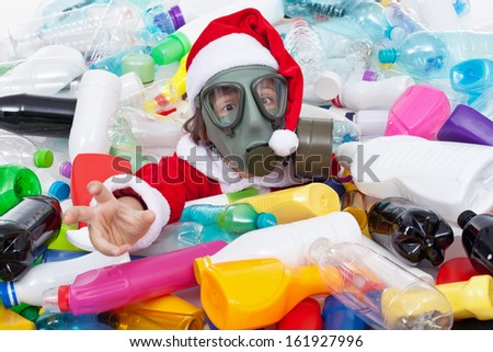 Toxic christmas - santa drowning in plastic bottles, environment concept - stock photo