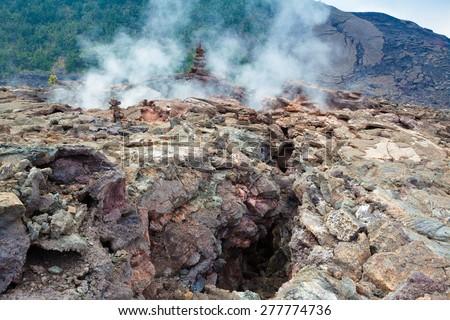 Toxic sulfur fumes and volcanic vents at the barren bottom of Kilauea Crater in Hawaii Volcanoes National Park, Big Island, Hawaii - stock photo