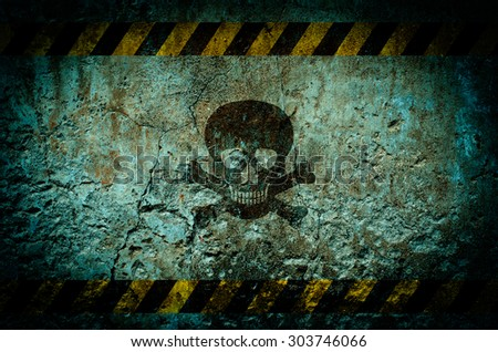 Toxic warning symbol on dirty wall background with grunge and vignette tone - stock photo