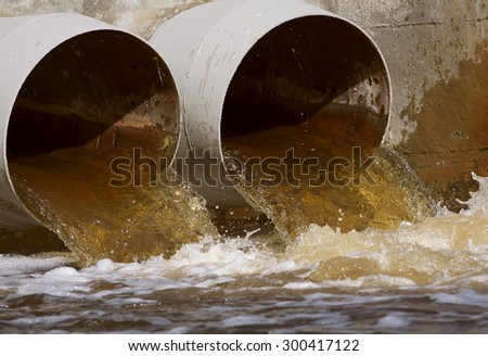 Toxic water running from sewers - stock photo