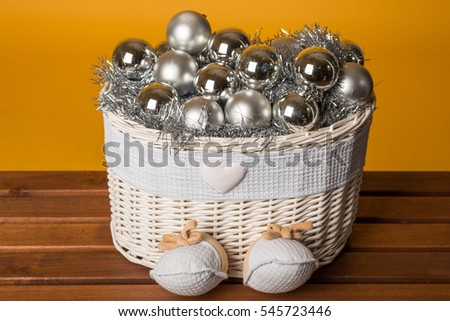 Toy basket with the silver balls for decoration of fir tree. Decor for Christmas and New Year.