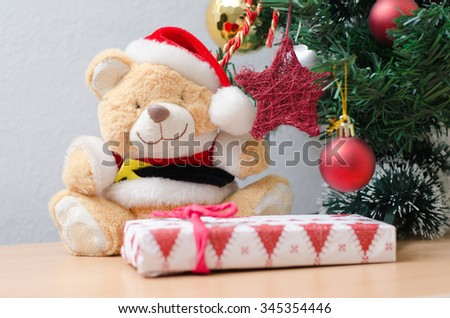 Toy bear with Christmas tree, decoration and gifts