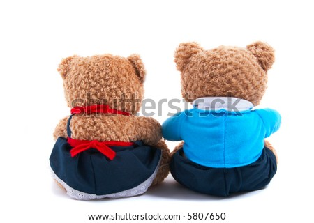 Toy bears (non branded) dress up as a couple, with shirt and tie and dress. Together back view, closeup. Could be useful to show them viewing a scene. - stock photo