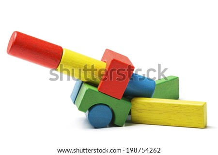 toy blocks cannon, multicolor artillery wooden gun, military defense concept, isolated white background - stock photo