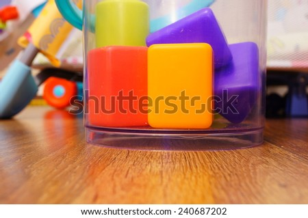 Toy blocks in a bucket - stock photo
