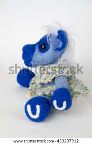 Toy blue horse on white background. Symbol of year on the Eastern calendar. Gift for holiday. Handmade Felt.