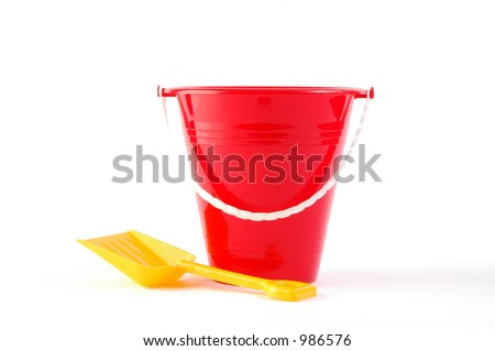 Toy bucket and shovel on white background - stock photo