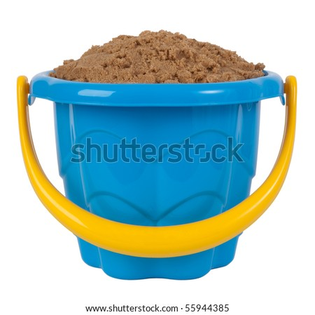 Toy bucket filled with sand - stock photo