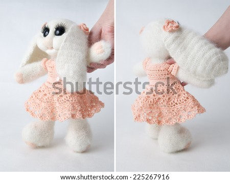Toy bunny on white background. Gift for holiday. Handmade Felt. - stock photo