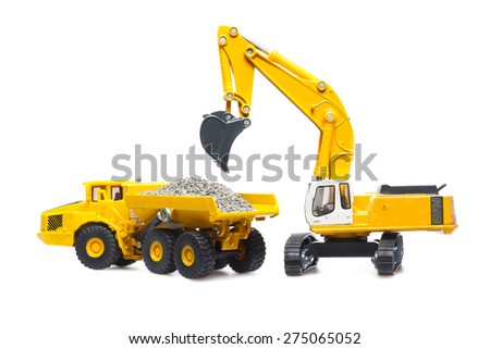 toy cable excavator is loading of heavy dump-body track on white background  - stock photo