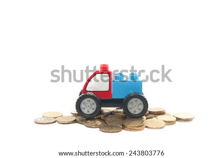 Toy Car on Malaysian Gold Coin on bright background - stock photo