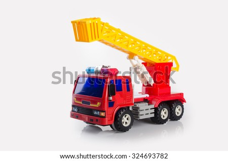 toy car. toy fire car on background. toy fire car on the background - stock photo