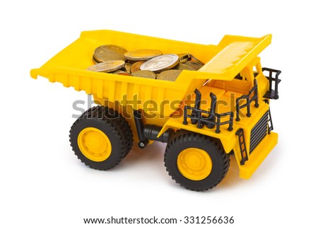 Toy car truck with money coins isolated on white background - stock photo