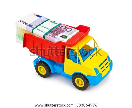 Toy car truck with money isolated on white background - stock photo