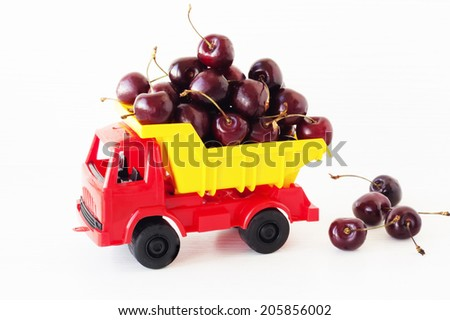 toy car with a sweet cherry in the back - stock photo