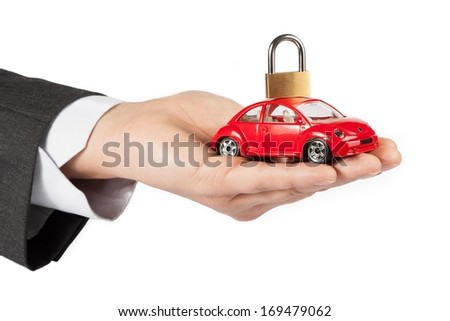 toy car with lock on top in the hand of business man on white background, concept for insurance, buying, renting, fuel or service and repair costs - stock photo