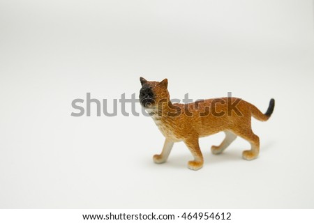 Toy cat from plastic on a white background